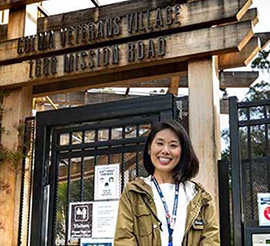 Postdoc Anna Oh outside of the Colma Veterans Village